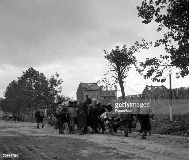 World War Two 15th October 1944 Aachen Germany German civilians hurry away from their devastated homes in Aachen during the Allied advance