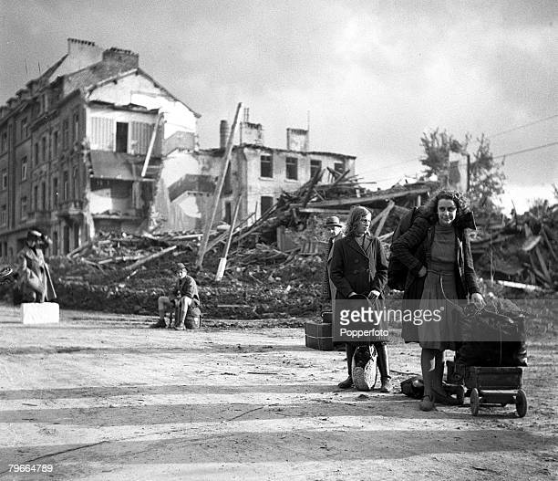 World War Two 15th October Aachen Germany German civilians carry their belongings away from the ruins of the German town of Aachen during the Allied...