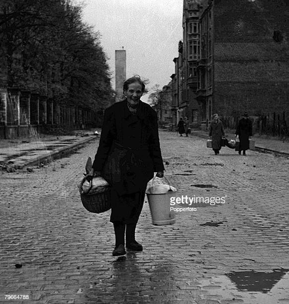 World War Two 18th October 1944 Aachen Germany An old lady carries her belongong as she awaits evacuation from Aachen where Allied forces invaded the...