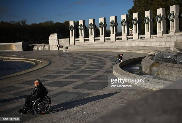 World War Two and Korean war veteran Frank Rigo age 91 and a member of the Paralyzed Veterans of America waits for the start of a Veterans Day...