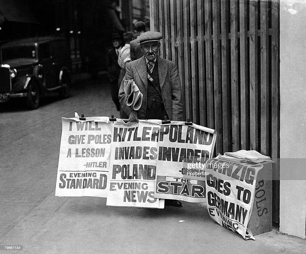 World War Two, Britain, 1st September 1939, A Newspaper vendor in a London street displays his headlines announcing the German invasion of Poland led by Nazi dictator Adolf Hitler : News Photo