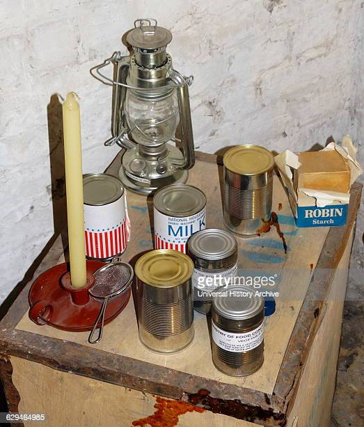 World War Two canned provisions with oil lamp from an air raid shelter in London England 1941