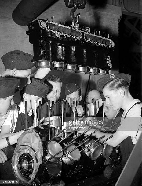 World War Two, England, 11th August Royal Air Force cadets receiving instructions on the cylinders of a Rolls Royce aero engine during a training...