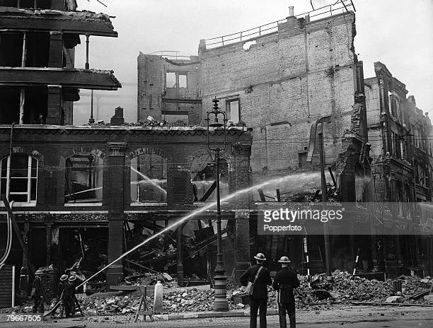 World War Two England 8th September Firemen spray bombed out shops and flats with water cannons after heavy German bombing destroyed many buildings...