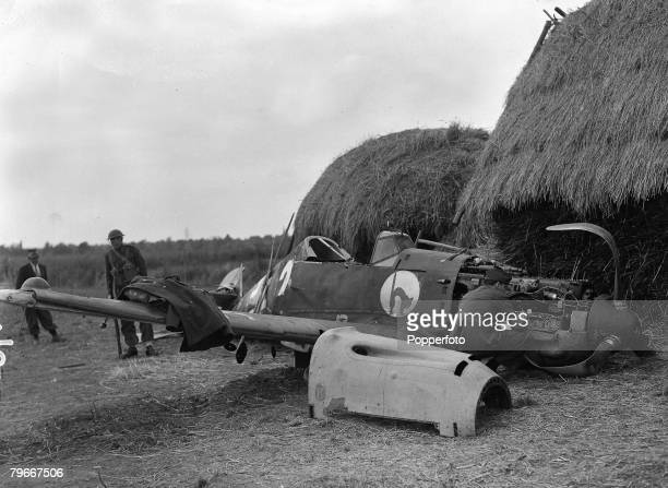 World War Two England 9th October A German Messerschmidt 109 plane lies destroyed on the ground after it had crashed into a haystack on the outskirts...