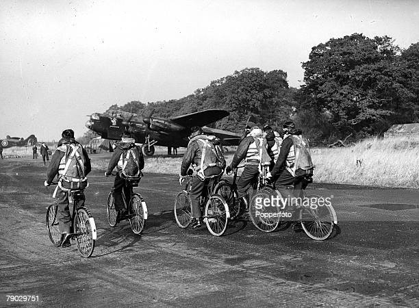 World War Two England RAF Bomber Command Base Flight crews cycle to their Lancaster bomber aircraft in order to reduce motor transport