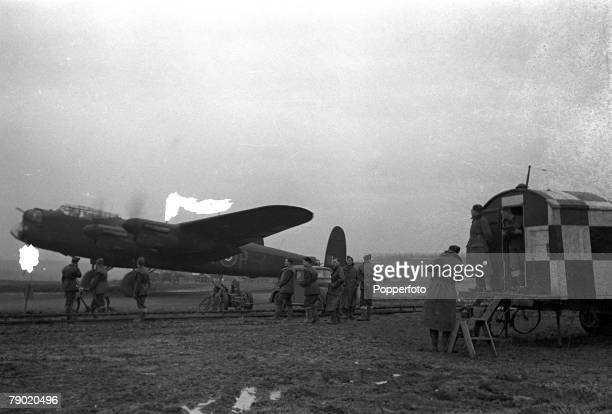 World War Two England RAF Bomber Command Royal Air Force crews prepare to take off on a bombing mission to Berlin in their Avro Lancaster planes