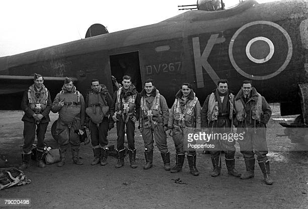 World War Two England RAF Bomber Command Royal Air Force crews prepare to take off on a bombing mission to Berlin in their Avro Lancaster heavy bomber