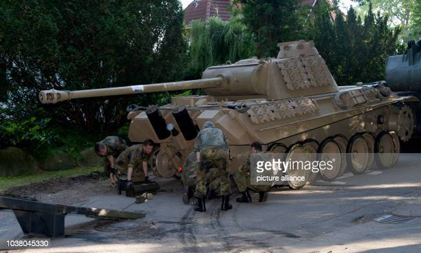World War Two era Panther battle tank is made ready for transportation from a residential property in Heikendorf, Germany, 02 July 2015. Since 01...