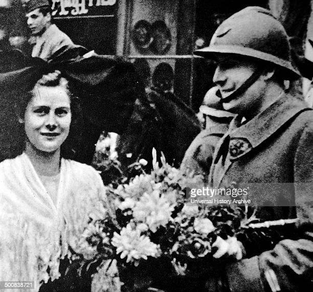 World War Two French soldier receives flowers from a woman in Alsace Lorraine 1940