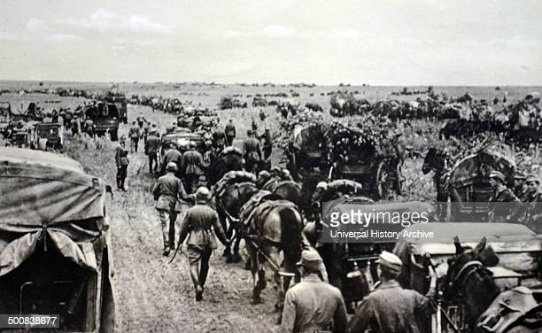 World War Two, German army postcard showing a column of infantry moving across Russia.