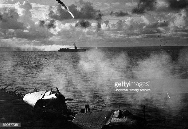 Japanese plane is shot down while attempting a suicide attack on the USS Kitkun Bay 1 January 1945.