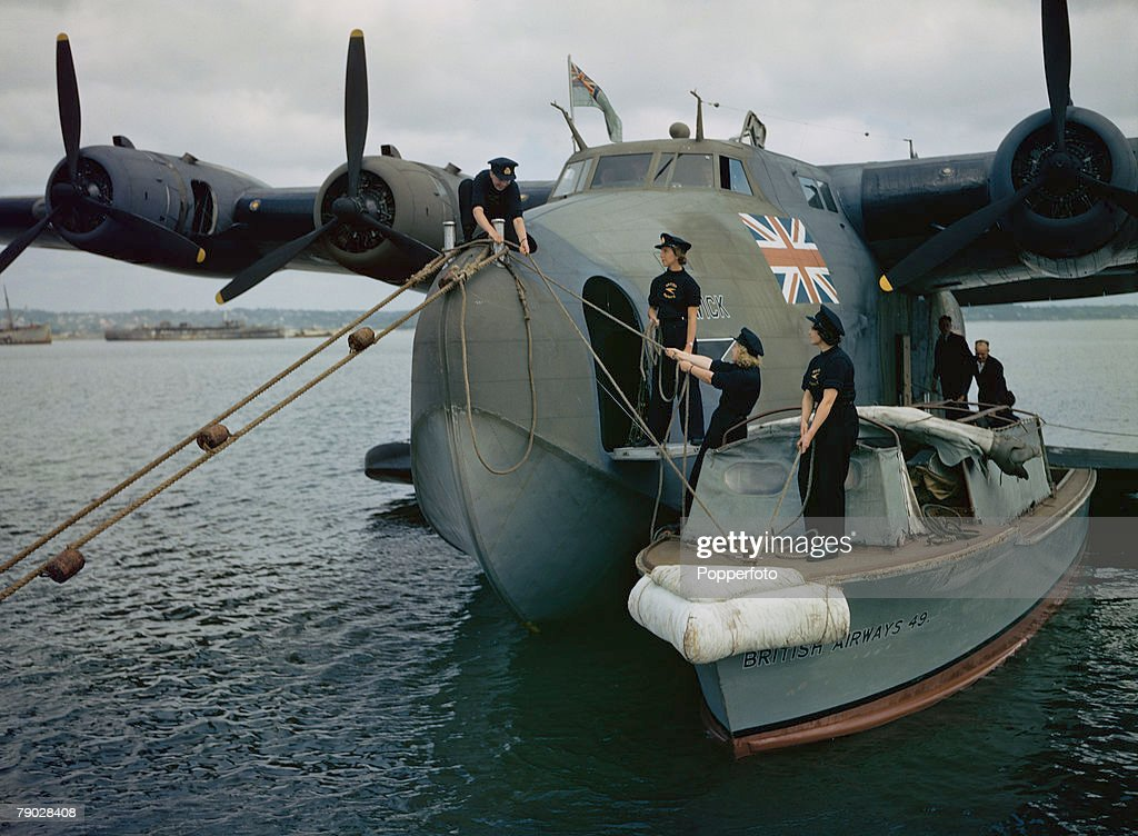 World War Two June 1943: Female Seamen of BOAC moor the Boeing 314a Clipper flying boat +Berwick+. : News Photo