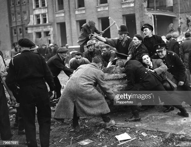 World War Two London England 20th January Police Firemen civil defence soldiers and civillians all work frantically in the work of rescue in the...