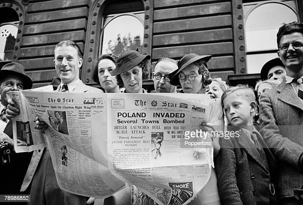World War Two London England September 3rd 1939 People reading newspapers while waiting outside 10 Downing Street to hear the Declaration of War...