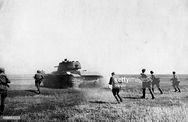 World War Two Soviet tommygunners attacking in the Voronezh Sector under cover of tanks October 1942