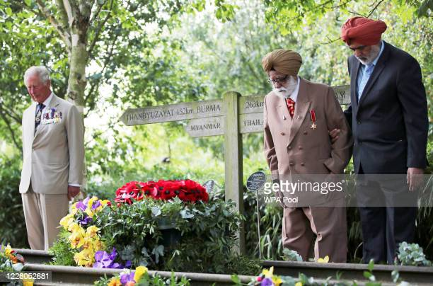 World War Two veteran Darbara Singh Bhullar lays a wreath beside Prince Charles Prince of Wales lays a wreath at the VJ Day National Remembrance...