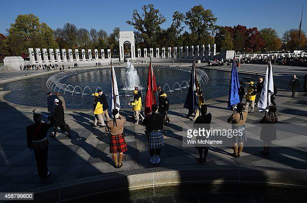 World War Two veterans participate in a wreath laying ceremony at the World War Two Memorial during a Veterans Day ceremony November 11 2014 in...