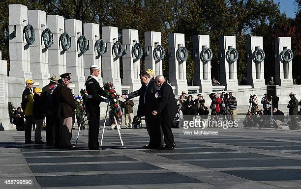 World War Two veterans place a wreath at the World War Two Memorial during a Veterans Day ceremony November 11 2014 in Washington DC Originally...