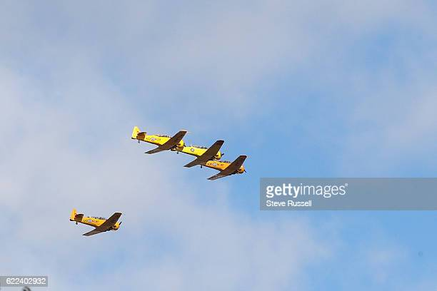 TORONTO ON NOVEMBER 11 World War Two vintage aircraft fly over in the missing man formation A Remembrance Day ceremony is held in the Military Burial...