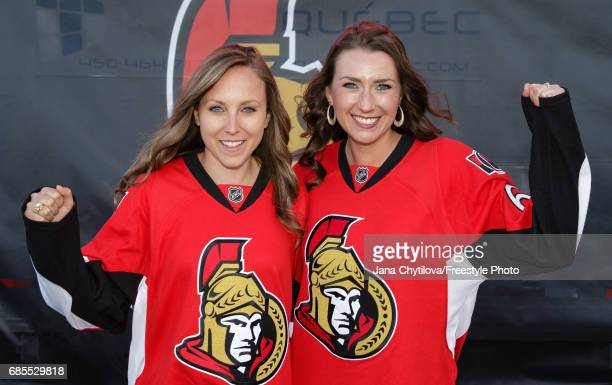 World Women's Curling Champions Rachel Homan and Emma Miskew of Team Homan pose prior to a game between the Ottawa Senators and the Pittsburgh...