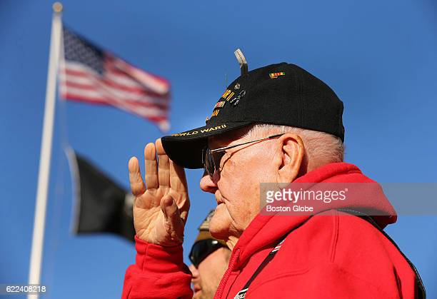 World World II Army veteran Francis X Murphy from Whitman salutes during the National Anthem during a Veterans Day Commemoration Ceremony for the...