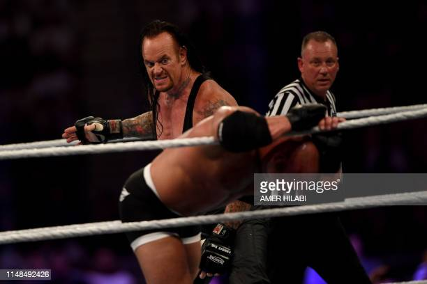 World Wrestling Entertainment star The Undertaker competes against Goldberg during the World Wrestling Entertainment Super Showdown event in the...