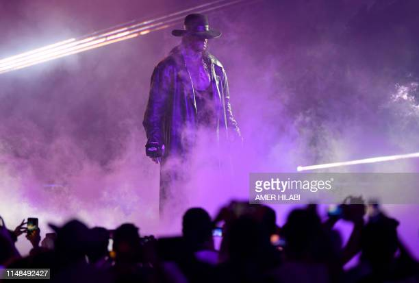 TOPSHOT World Wrestling Entertainment star The Undertaker makes his way to the ring during a match at the World Wrestling Entertainment Super...