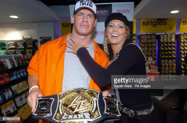 World Wrestling Entertainment stars Jon Cena and Torrie Wilson clown for the cameras before signing copies of new DVD, 'Royal Rumble 2005'.