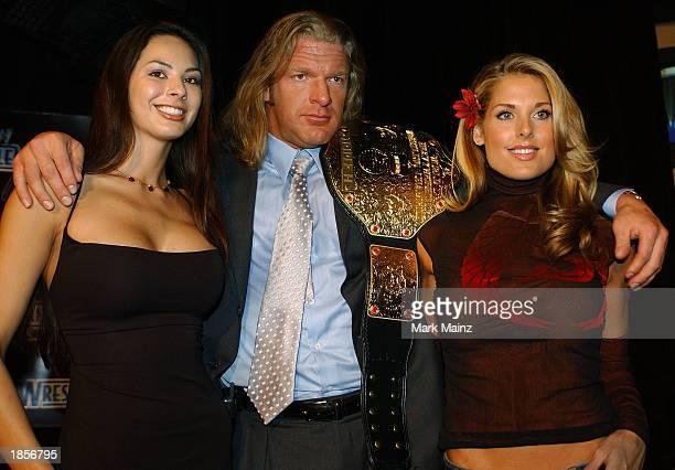 World Wrestling Entertainment Wrestler Triple H and the Miller Light Catfight Girls Kitana Baker and Tanya Ballinger attend a media conference...