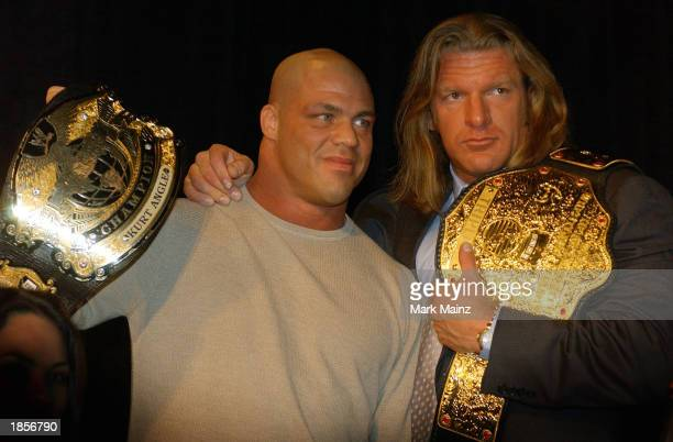 World Wrestling Entertainment Wrestlers Kurt Angle and Triple H attend a media conference announcing the all-star lineup of WWE WrestleMania XIX at...