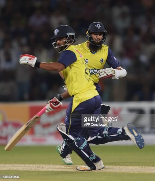 World XI batsmen Hashim Amla and Tamim Iqbal run between the wicket during the second Twenty20 International match between the World XI and Pakistan...