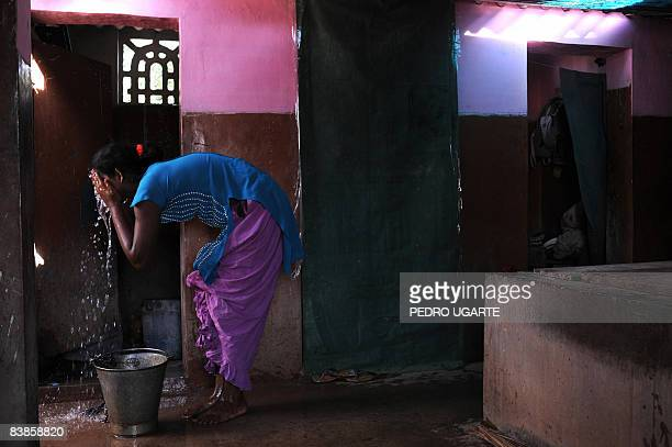 WorldAIDSIndiaprostitutionFEATURE BY PHIL HAZLEWOOD Savitah a member of the Indian hijra community or commonly called eunuch washes her face at her...