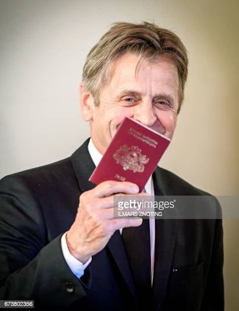 Worldfamous dancer and actor Mikhail Baryshnikov poses with a Latvian passport after he was granted Latvian citizenship in Riga Latvia on April 27...