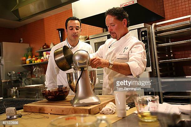 Worldrenown chef Stephan Pyles provides a cooking demonstration for twotime Indy 500 champion Helio Castroneves at the Stephan Pyles Restaurant May...
