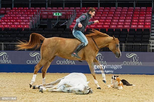 Worldrenowned equestrian artist Santi Serra performs with horses and dogs as part of the London International Horse Show 2016 in London United...