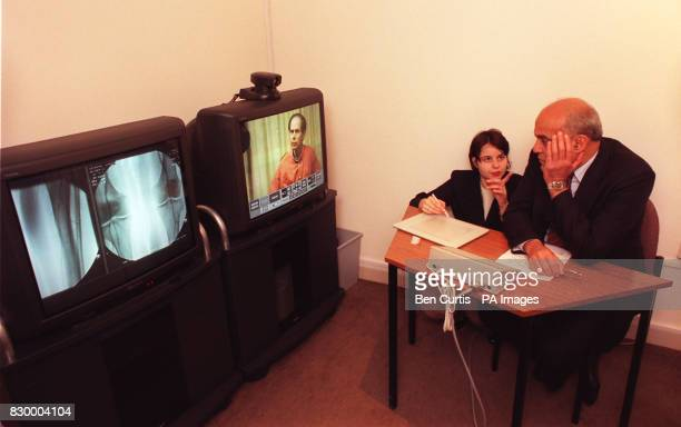 Worldrenowned surgeon Professor Magdi Yacoub is shown how to use the new telemedicine technology by the Directorate Manager of Surgery Lucy Samuels...