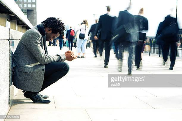 worlds apart, a man begging the busy streets of london - humility stock pictures, royalty-free photos & images