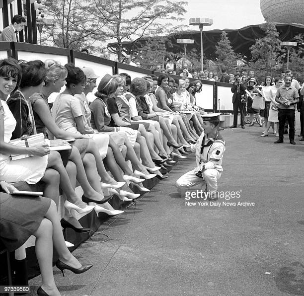 World's Fair Jesus Sopelana of Spain a sailor on the SS Juan Sebastian de Elcano looks over the contestants for The prettiest legs at the Fair