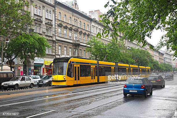 world's longest tram in pouring budapest rain - boulevard stock pictures, royalty-free photos & images