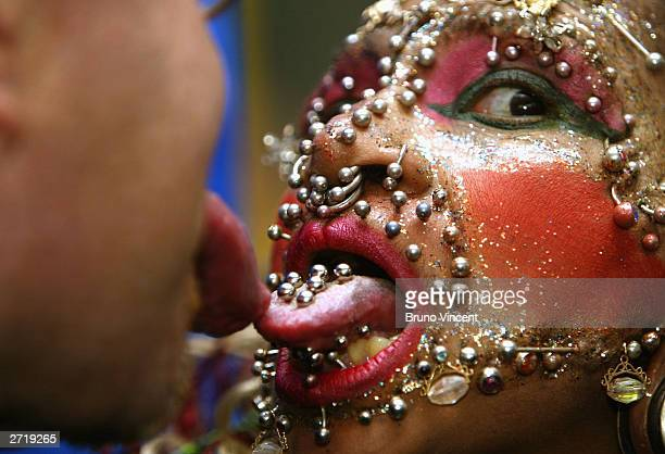 Worlds most pierced woman Elaine Davidson and man with longest tongue Stephan Taylor pose for photographers at the photocall for the 100 millionth...