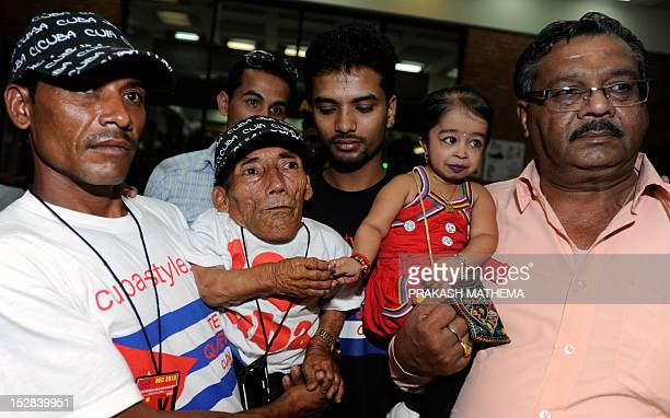World's shortest man Nepalese Chandra Bahadur Dangi poses while shaking hands with Indian Jyoti Amge the world's shortest woman upon her arrival at...