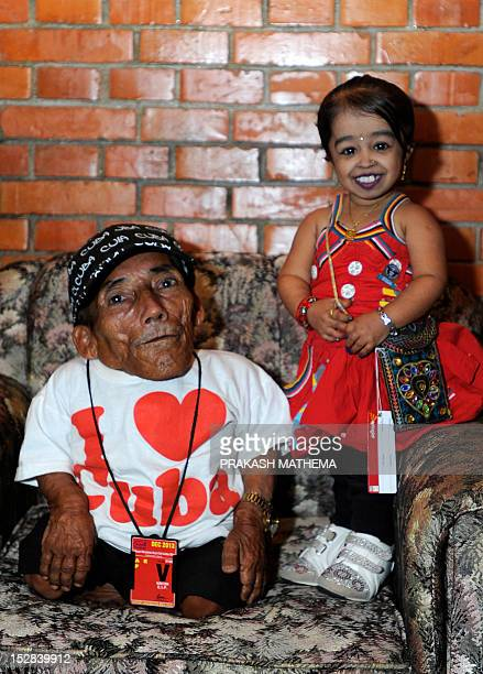 World's shortest man Nepalese Chandra Bahadur Dangi poses with Indian Jyoti Amge the world's shortest woman upon her arrival at Tribhuvan...