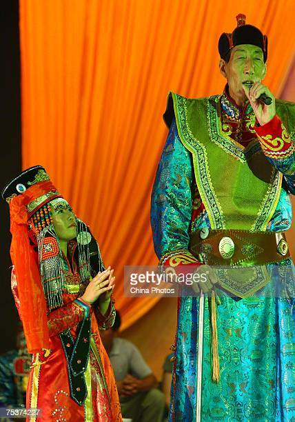 World's tallest man Bao Xishun and his bride Xia Shujuan attend their traditional Mongolian wedding ceremony at Genghis Khan's Mausoleum on July 12...
