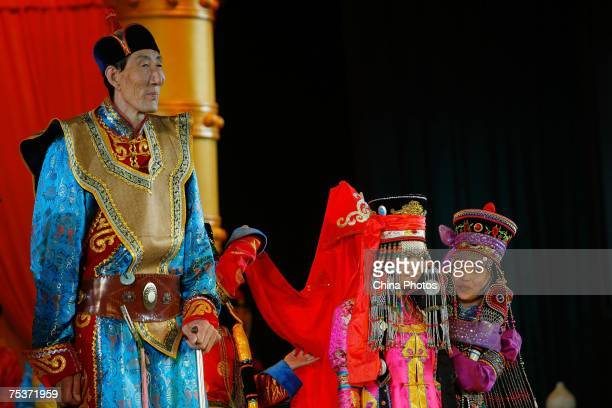 World's tallest man Bao Xishun as his bride Xia Shujuan is unveiled during their traditional Mongolian wedding ceremony at Genghis Khan's Mausoleum...