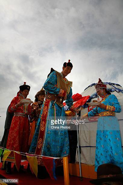 World's tallest man Bao Xishun gets off a cart during his traditional Mongolian wedding ceremony at Genghis Khan's Mausoleum on July 12 2007 in the...