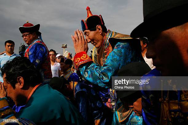 World's tallest man Bao Xishun prays during his traditional Mongolian wedding ceremony with his bride Xia Shujuan at Genghis Khan's Mausoleum on July...