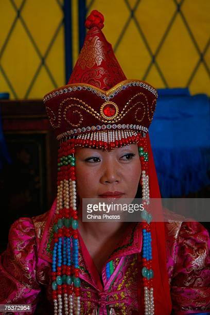 World's tallest man Bao Xishun's bride Xia Shujuan attends her traditional Mongolian wedding ceremony at Genghis Khan's Mausoleum on July 12 2007 in...