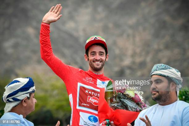UCI WorldTeam Team KatushaAlpecin's Australian rider Nathan Hass gestures as he stands on the podium after winning the second stage of the 2018...