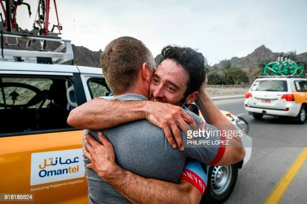 UCI WorldTeam Team KatushaAlpecin's Australian rider Nathan Hass hugs a man as he celebrates after winning the second stage of the 2018 cycling Tour...